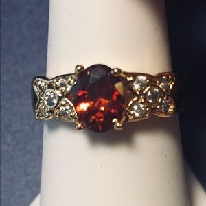 Pretty Goldtone Oval Center Crystal Ring